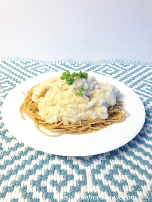 Creamy chicken Alfredo sauce made out of cauliflower from Houseful of Handmade.