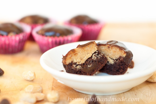 Peanut Butter Cup Brownie Bites shown on counter with white plate