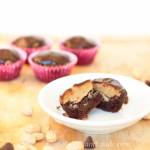 Peanut Butter Cup Brownie Bites are a fancier take on a Reese's Peanut Butter cup. A brownie bite is layered with peanut butter cup filling and topped with chocolate ganache. Recipe on Houseful of Handmade.