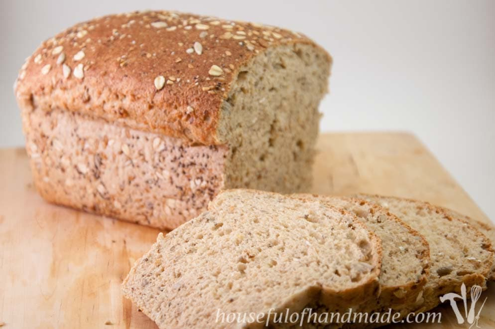 This bread is so delicious! A soft but hearty whole grain seed bread made with whole wheat, oats and seeds. Recipe on Houseful of Handmade.