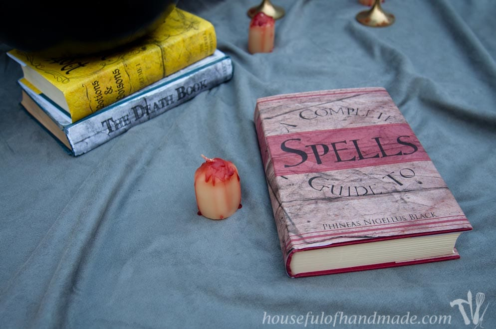 Make these easy Halloween book covers to transform your home for Halloween this year. Housefulofhandmade.com