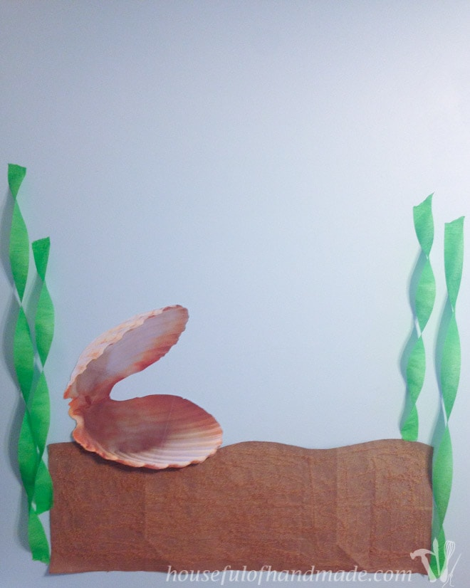 Pin the pearl in the clam backdrop for a mermaid themed tea party