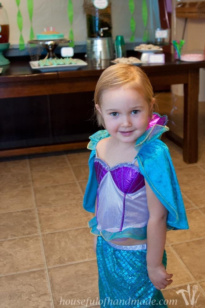 Toddler in a mermaid costume during her little mermaid birthday party.