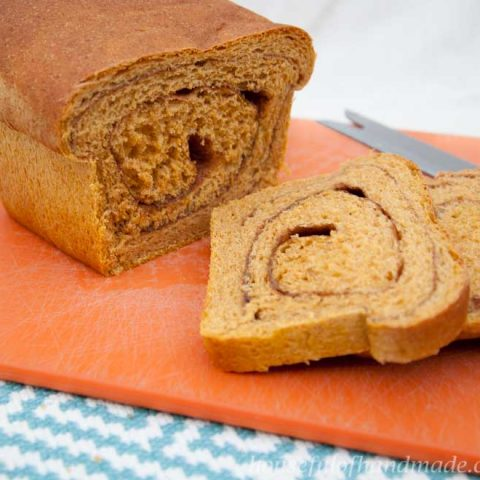 This is the most delicious bread. It is a soft & light pumpkin yeast bread with a cinnamon swirl inside. Recipe of Houseful of Handmade.