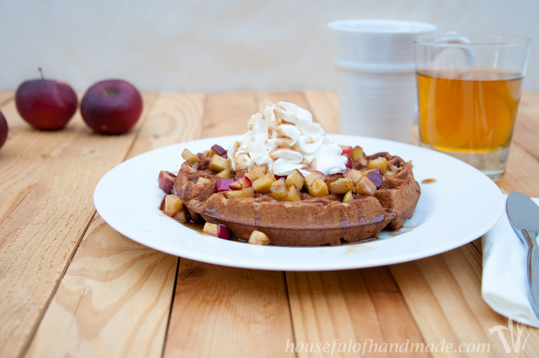 Dessert for breakfast? Why not! These delicious caramel apple pie waffles put a slice of dessert on your waffle with caramelized apples over a crisp, but chewy, waffle loaded with more apple goodness. | HousefulofHandmade.com