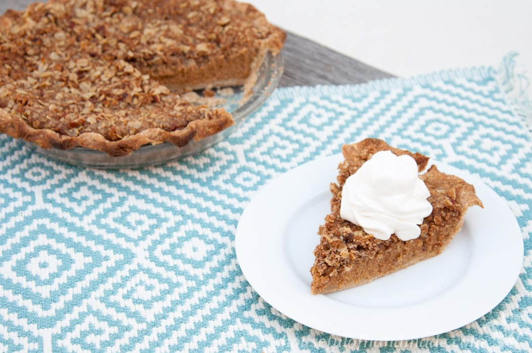 This pie is amazing! It's a new twist on the classic pumpkin pie. This Apple Butter Pumpkin Pie with Crumb Topping is perfect for your Thanksgiving table, or anytime. | HousefulofHandmade.com