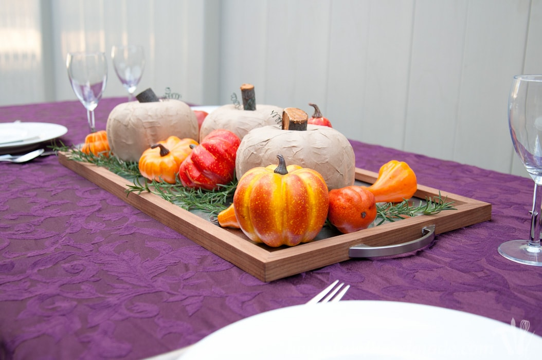 These pumpkins are beautiful. It's hard to believe they were ugly dollar store pumpkins. See how to make easy rustic pumpkins from dollar store pumpkins for only a couple dollars! | HousefulofHandmade.com