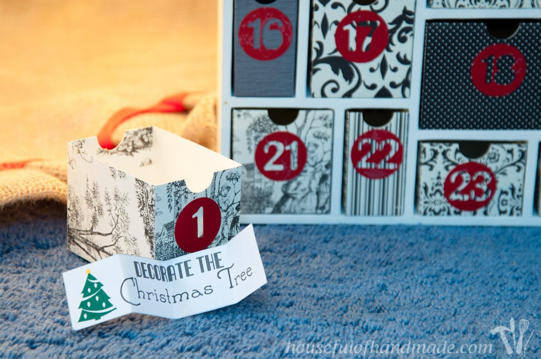 diy advent calendar box with activity paper in front
