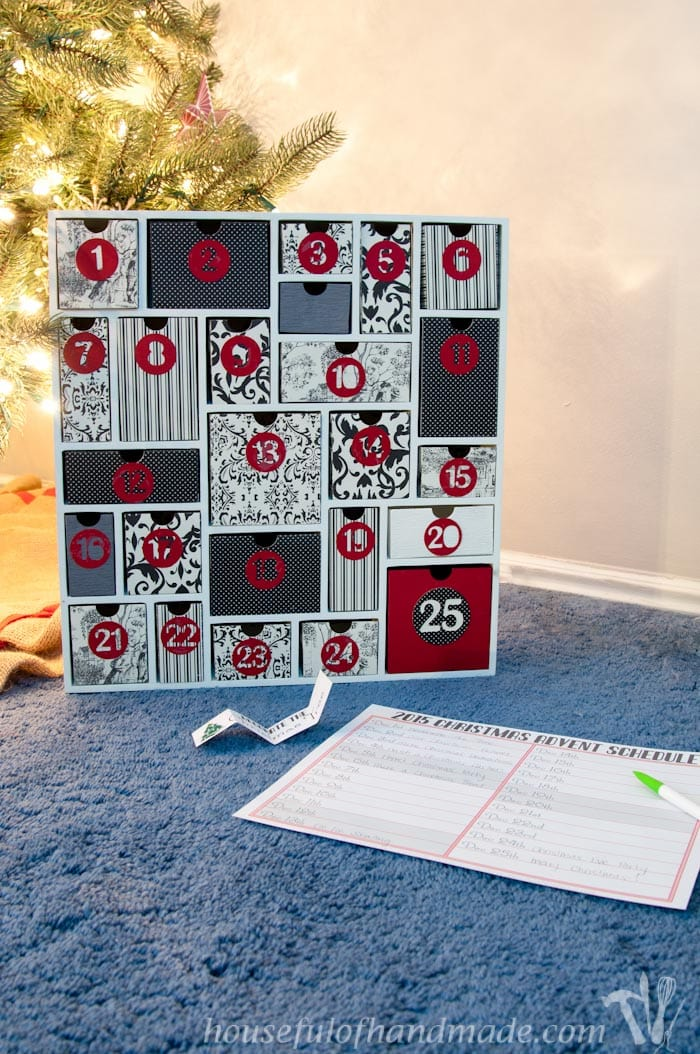 diy advent calendar on the floor in front of a christmas tree