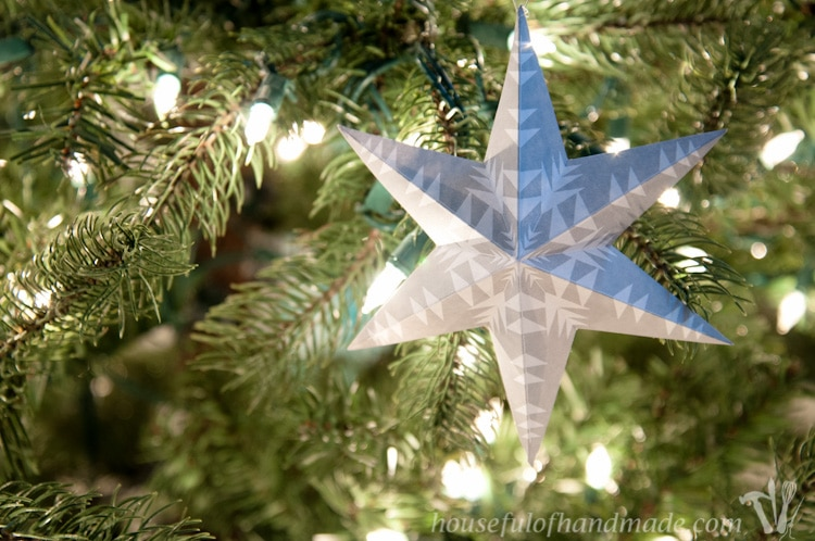 diy paper ornament hanging in a christmas tree