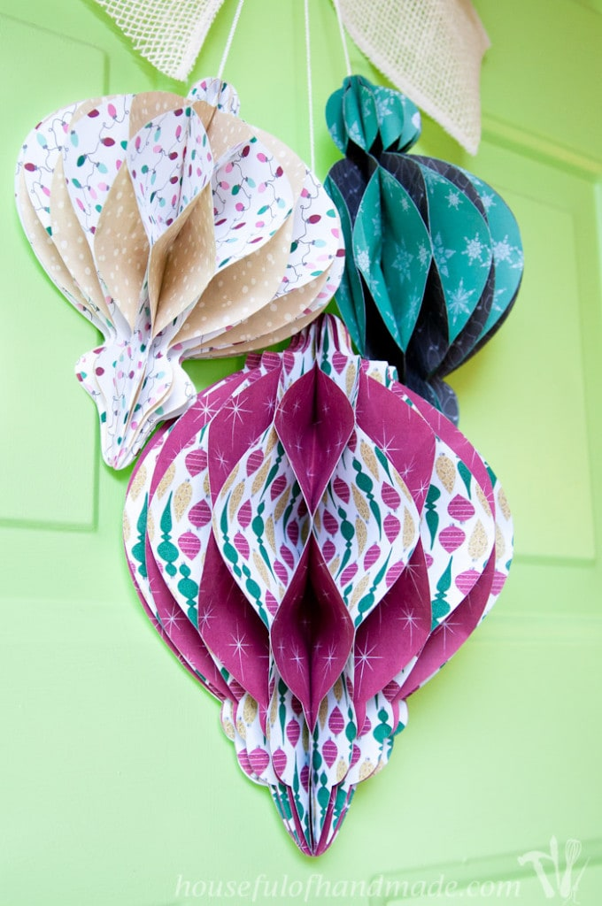 Decorate your door with this beautiful DIY giant paper ornament Christmas wreath. Fun and easy to make! | Housefulofhandmade.com