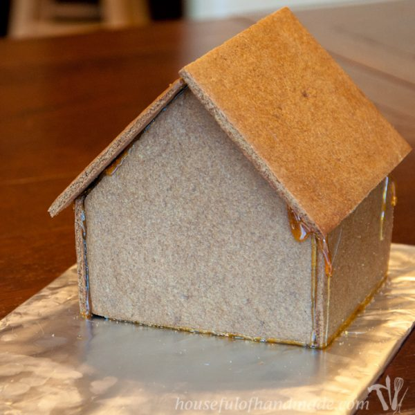 """Don't let frustration over putting together gingerbread houses keep you from making traditions with your family. Use """"Hot Glue"""" to put it together instead! This tutorial shows you how to easily assemble a gingerbread house with melted sugar. 