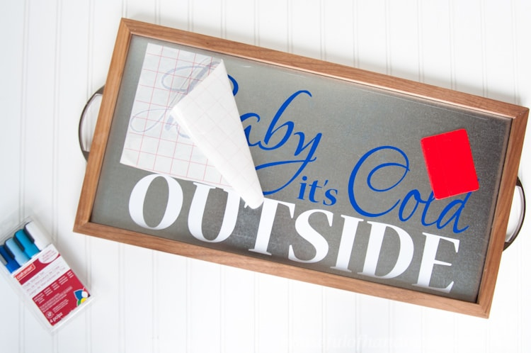 Time to warm up with this adorable decor for your hot cocoa or coffee station. Make a Baby It's Cold outside sign out of a DIY metal serving tray!   Housefulofhandmade.com   Housefulofhandmade.com