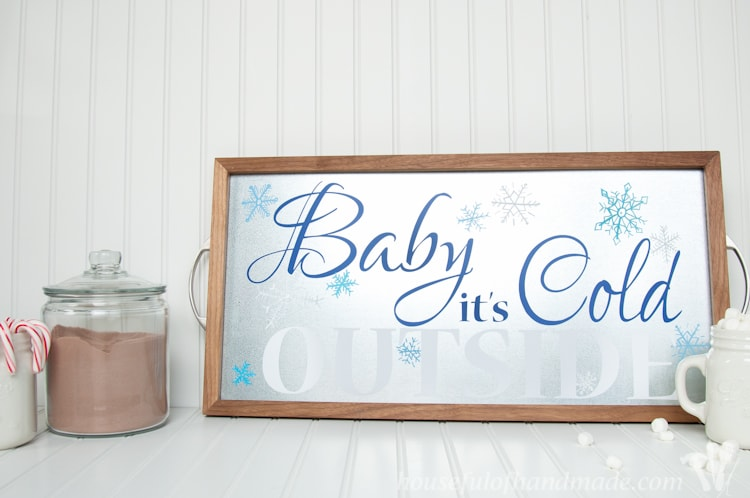 Time to warm up with this adorable decor for your hot cocoa or coffee station. Make a Baby It's Cold outside sign out of a DIY metal serving tray! | Housefulofhandmade.com | Housefulofhandmade.com