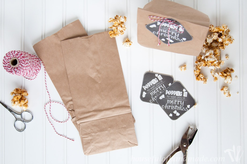 Easily assemble these cute popcorn gift bags with our free printable tag: Popping In to Wish you a Merry Christmas.