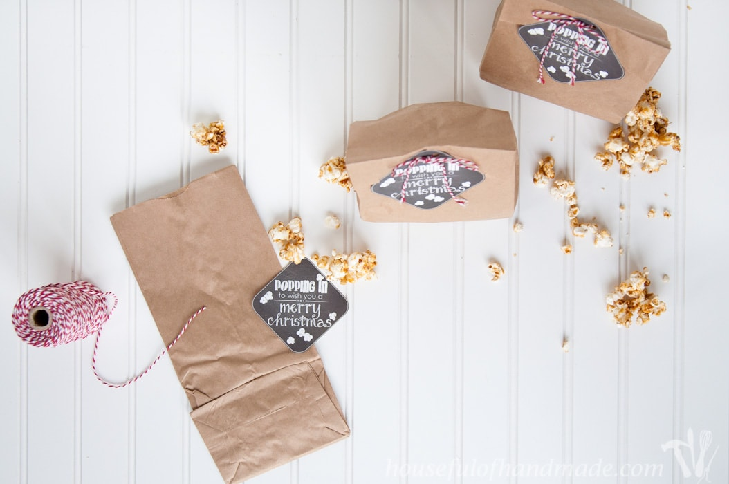 Gift the gift of popcorn this Christmas with these adorable Popping In free printable Christmas tags. Perfect for neighbor or teacher gifts. | Housefulofhandmade.com