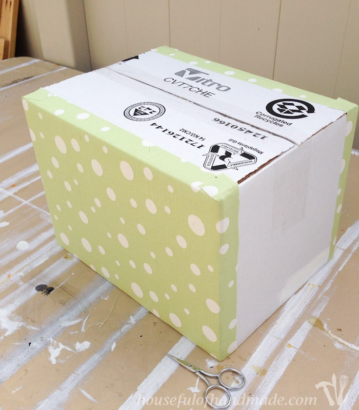 cardboard box shown with fabric on two sides
