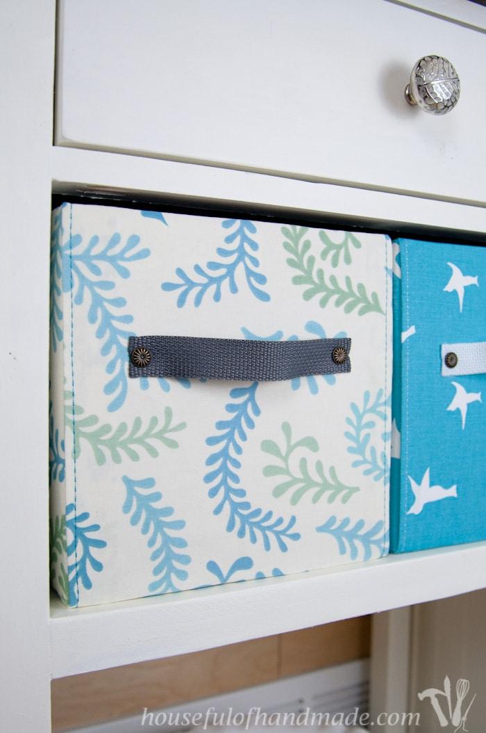 finished diy fabric storage boxes shown on shelf