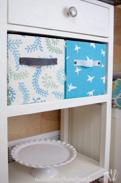 diy fabric storage boxes shown in coffee station on shelf