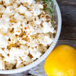 This popcorn is awesome! Brighten up your favorite snack with fresh herbs and citrus. This Lemon Rosemary Popcorn is the perfect combination for a light and airy treat. | Housefulofhandmade.com