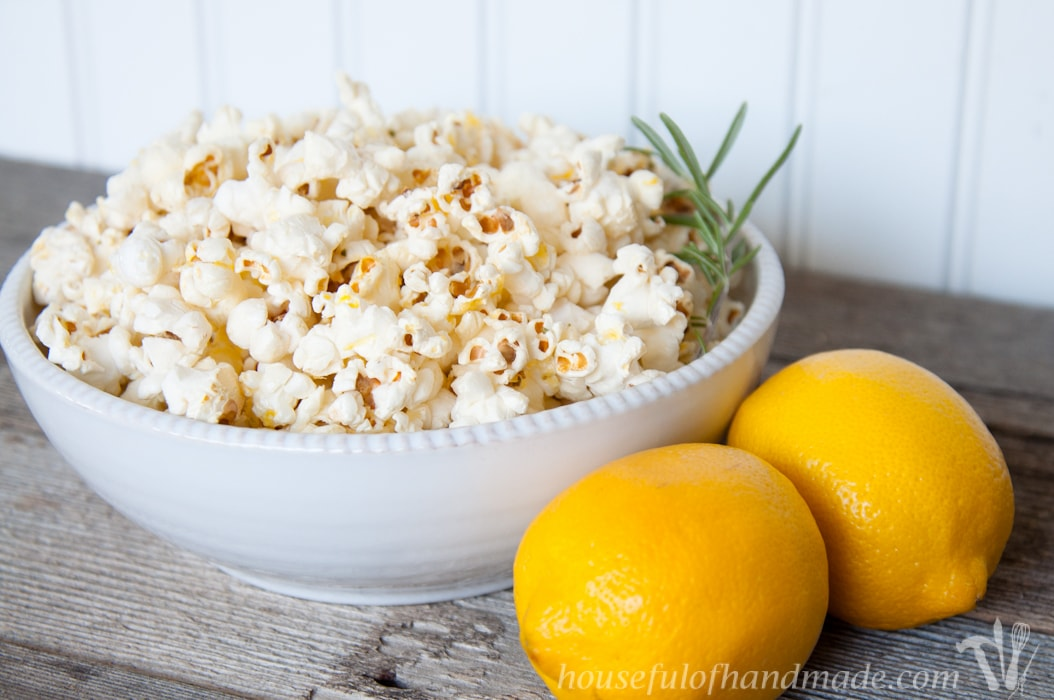 This popcorn is awesome! Brighten up your favorite snack with fresh herbs and citrus. This Lemon Rosemary Popcorn is the perfect combination for a light and airy treat.   Housefulofhandmade.com