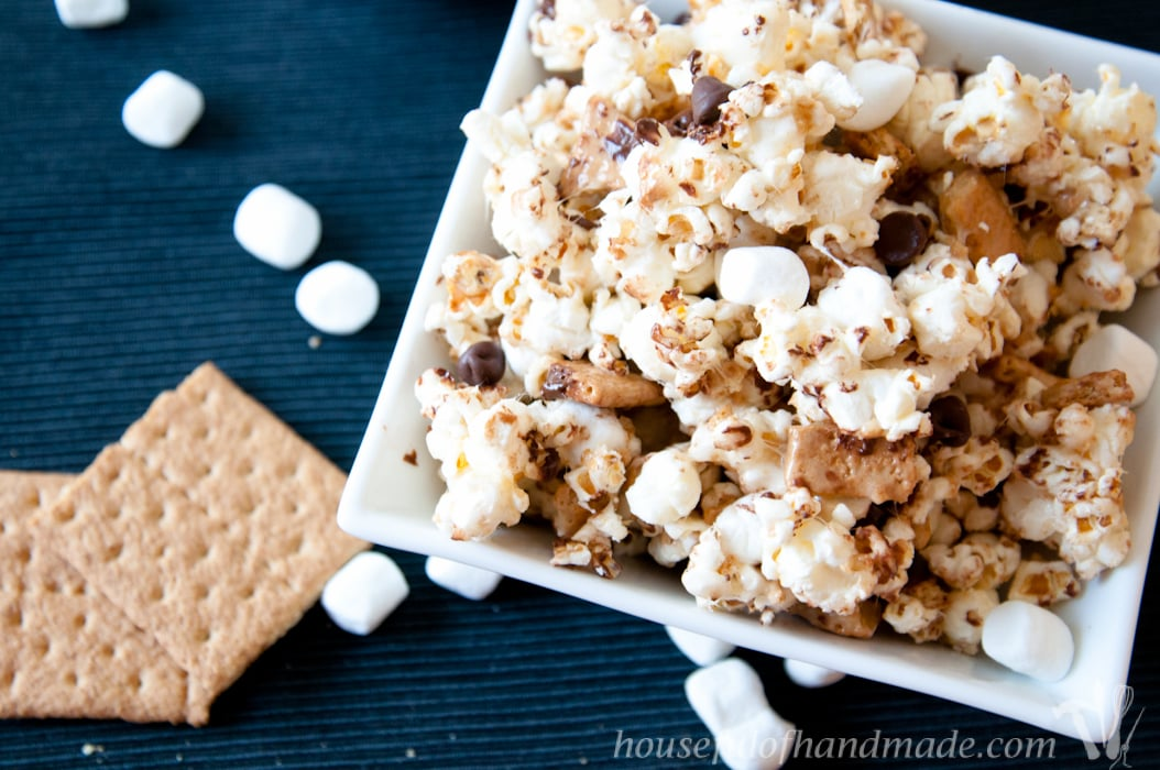 This is the best gooey popcorn. A mix of marshmallow, chocolate, and graham cracker make this super delicious S'mores Caramel Popcorn. | HousefulOfHandmade.com