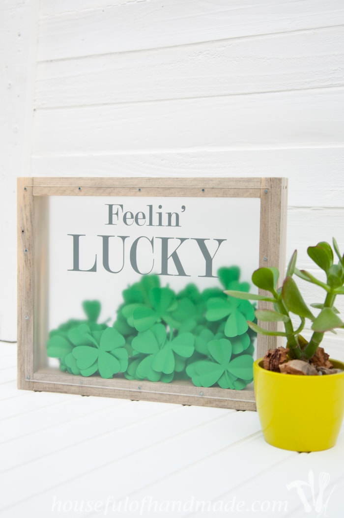 I love this fun St. Patrick's Day shadow box. The perfect way to bring a little green to your decor.   Housefulofhandmade.com