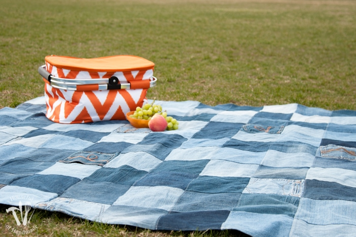 Picnic basket and fruit on Water-resistant upcycled jeans picnic blanket