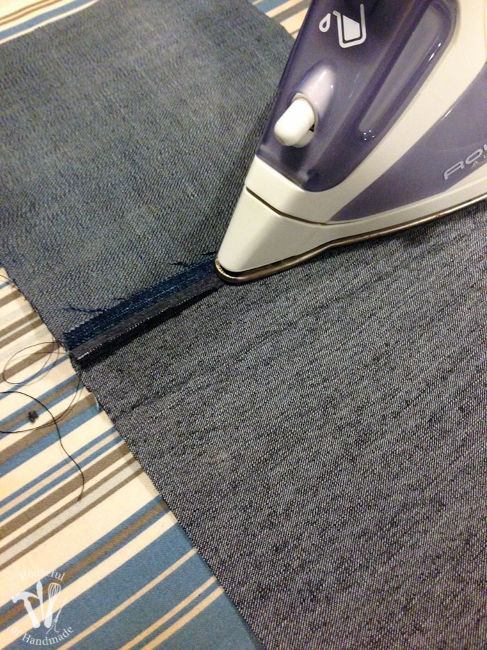 an iron on the seam of two jean pieces for a Water-resistant upcycled jeans picnic blanket