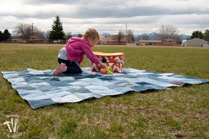Young girl on a water-resistand jean picnic blanket