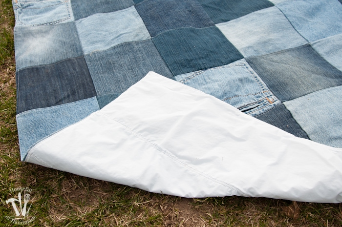 Water-resistant upcycled jeans picnic blanket folded to reveal plastic bottom