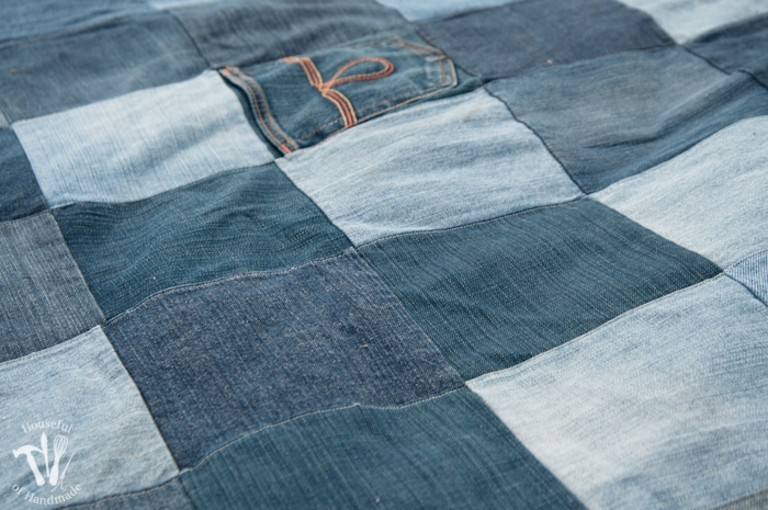 close up on quilted squares on a Water-resistant upcycled jeans picnic blanket
