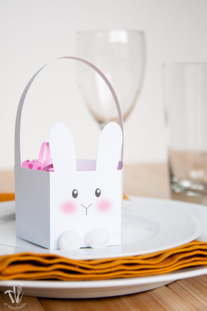 These boxes are the cutest! Celebrate Easter by filing these free printable bunny Easter baskets with your favorite treat. They are perfect for table settings and gifts. | Housefulofhandmade.com