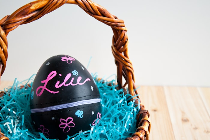 Turn boring decorative eggs into a jumbo chalkboard zipper Easter eggs to fill with clothes or toys. A simple and fun DIY for the perfect Easter basket! | Housefulofhandmade.com