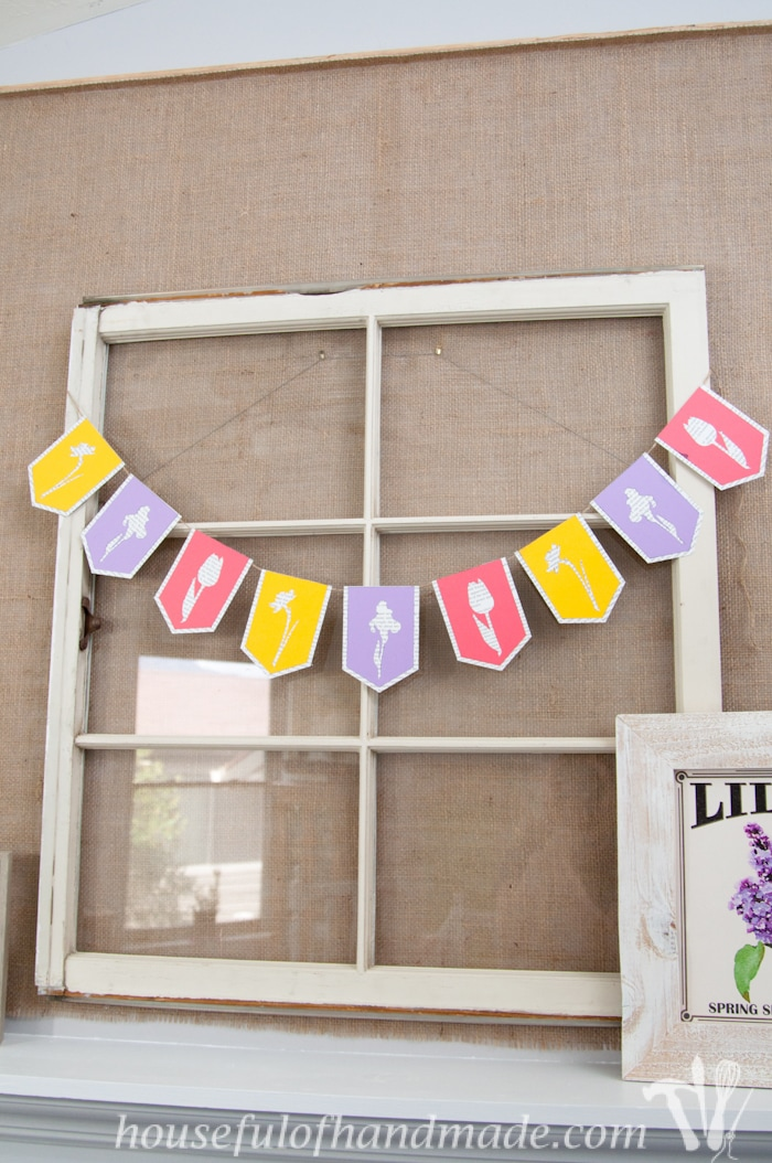 I love using banners to decorate. Create a beautiful spring flower & book page banner with this tutorial and free digital cut file. | Housefulofhandmade.com