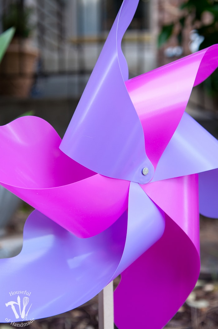 close up of finished pinwheel in purple and pink colors