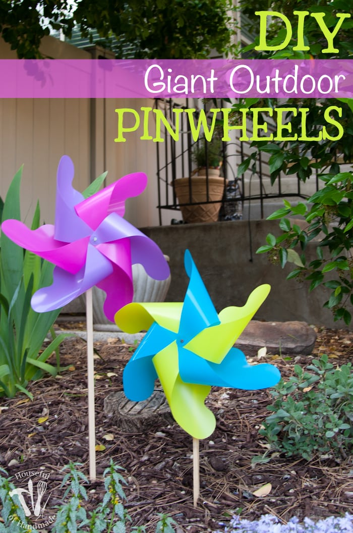 pinterest image of finished diy outdoor pinwheels shown in the outdoor garden area.