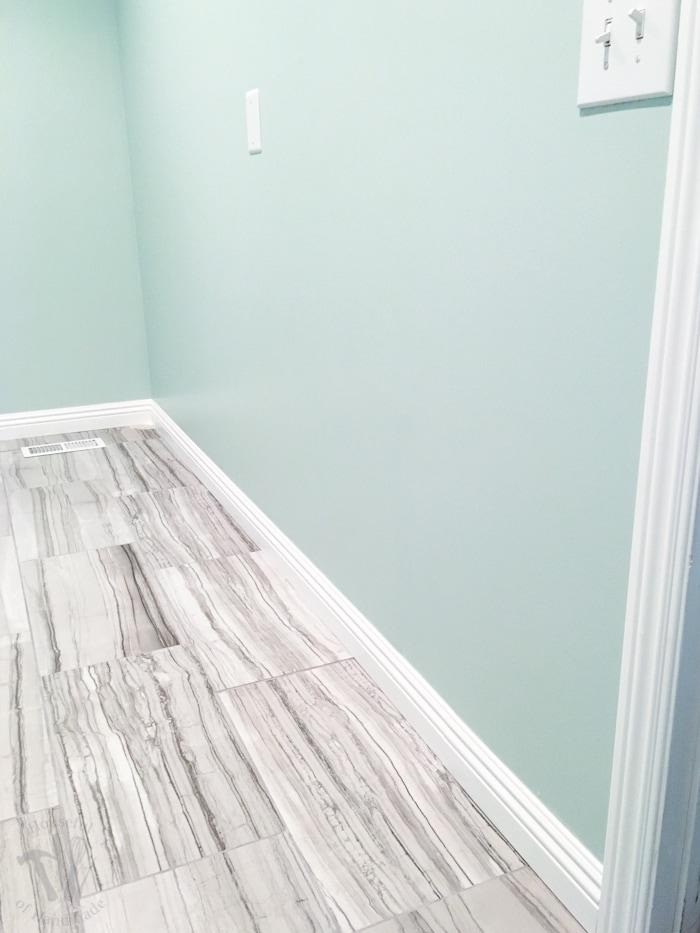 Master Bathroom Update Installing Baseboards And Door