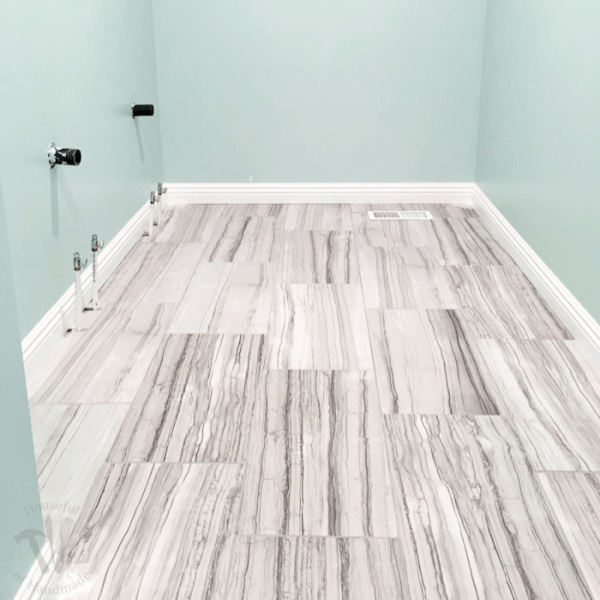 This week we installed baseboards into the master bathroom. While I continue to struggle with installing baseboards and door trim, I am really great at filling in any gaps with this cheater trick! | Housefulofhandmade.com