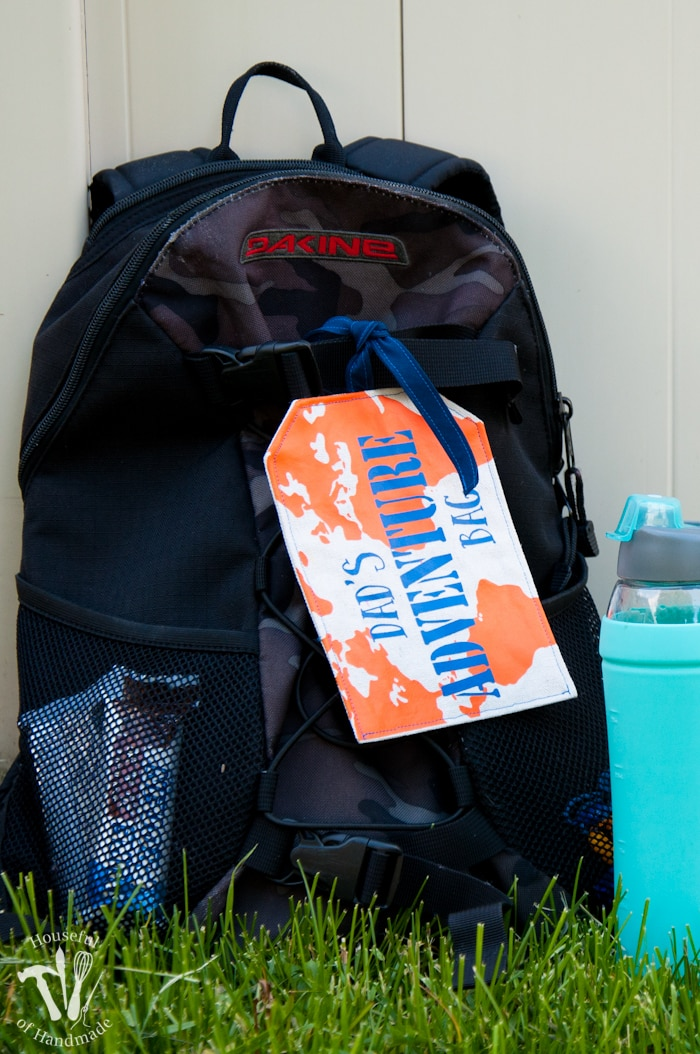 outdoor adventure git bag shown outside with water bottle