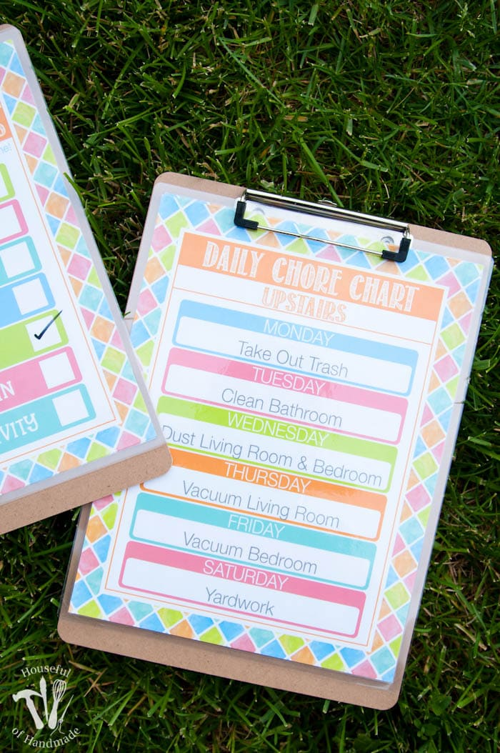 free summer printable chore chart shown on clipboard on grass