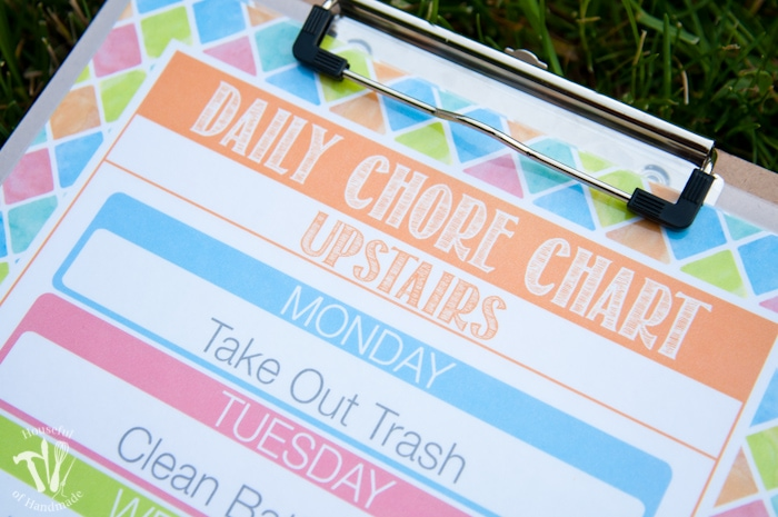 close up of free printable summer chore chart on clipboard