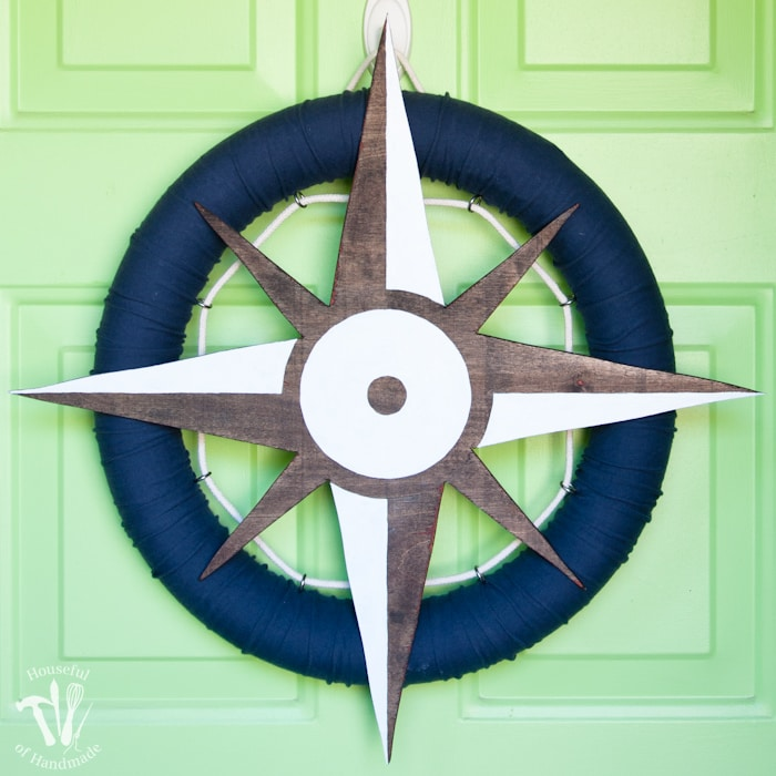 I love nautical decoration for summer! Make this fun nautical compass wreath to decorate your door with this year. | Housefulofhandmade.com