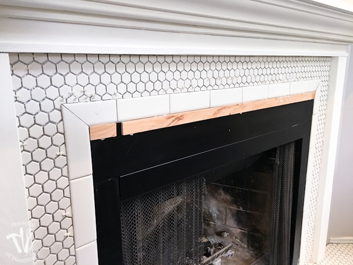 Remodeling our fireplace to make a beautiful, vintage inspired, farmhouse fireplace. All the details on Housefulofhandmade.com