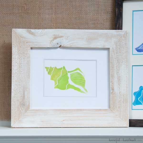 This is the perfect home decorating hack! Frame any picture with these easy DIY photo mats for around $1. Easy to customize to any size photo or frame. Includes free printable watercolor seashell prints. Housefulofhandmade.com