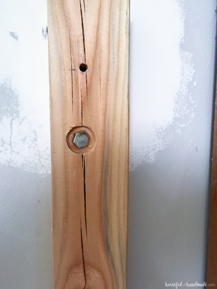 railing post shown attached to wall