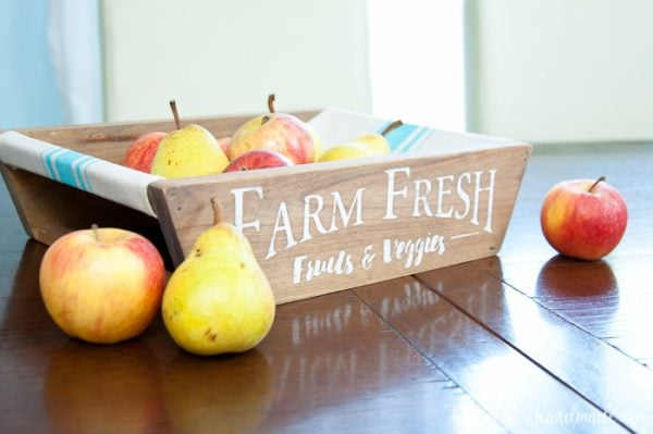 This is the most beautiful way to hold fruits and vegetables on the counter! This easy to make DIY farmhouse produce basket is a fun twist on a fruit crate. Perfect fall centerpiece to display all the produce from your garden. | Housefulofhandmade.com
