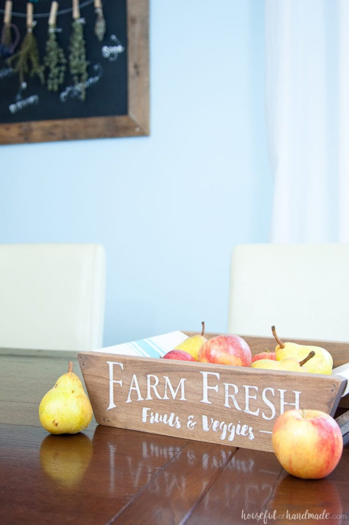This is the most beautiful way to hold fruits and vegetables on the counter! This easy to make DIY farmhouse style produce basket is a fun twist on a fruit crate. Perfect fall centerpiece to display all the produce from your garden.   Housefulofhandmade.com
