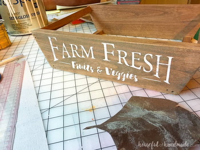 This is the most beautiful way to hold fruits and vegetables on the counter! This easy to make DIY farmhouse style produce basket is a fun twist on a fruit crate. Perfect fall centerpiece to display all the produce from your garden. | Housefulofhandmade.com