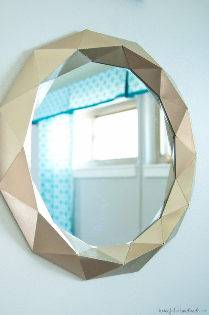 I cannot believe what she used to make this mirror! Decorating your home can get expensive, unless you get creative. This easy $10 Anthropologie mirror knock off tutorial shows you how to get huge style without the huge price tag. | Housefulofhandmade.com